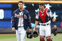 Gwinnett Braves starting pitcher Matt Wisler (45) walks to the dugout with catcher Braeden Schlehuber prior to a game against the Leigh Valley IronPigs at Coolray Field on May 25, 2015 in Lawrenceville, Georgia. (David Welker/Four Seam Images)