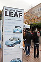 Information sign promoting Nissan Leaf electric car. Nissan Leaf Zero Emission Tour promotional event for the Nissan Leaf electric car that is scheduled to be released in Fall 2010. Car specs from Nissan: 5 person capacity, 90 MPH top speed, lithium-ion battery, 100 mile average range per charge. Santana Row, San Jose, California, USA, 12/5/09
