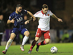 Southend's Stephen McLaughlin tussles with Sheffield United's Billy Sharp during the League One match at Roots Hall Stadium.  Photo credit should read: David Klein/Sportimage