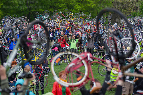 Participants raise their bikes marking the completition of their yearly tour on Earth Day around the city called Critical Mass demonstrating the importance and popularity of bicycle as a mean of everyday city transportation in Budapest, Hungary on April 22, 2012. ATTILA VOLGYI