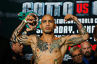 Puerto Rico boxer Miguel Cotto holds his arms up while he attends the scale during an official weigh-in ahead of his fight against Australia boxer Daniel Geale at Barclays Center in New York.  06/05/2015. Eduardo MunozAlvarez/VIEWpress