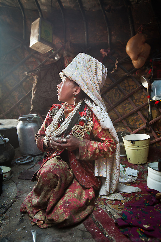 Gul Soon, Jim Boi's wife, in teh kitchen yurt..Summer camp of Muqur, Er Ali Boi's place...Trekking through the high altitude plateau of the Little Pamir mountains (average 4200 meters) , where the Afghan Kyrgyz community live all year, on the borders of China, Tajikistan and Pakistan.