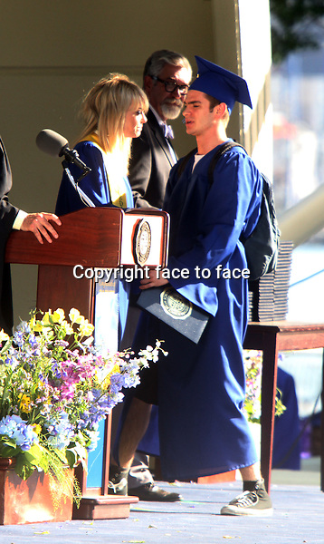 NEW YORK, NY - JUNE 1: Andrew Garfield as Spider-Man shooting a graduation day scene on the set of The Amazing Spider-Man 2 in New York City. June 1, 2103. <br />