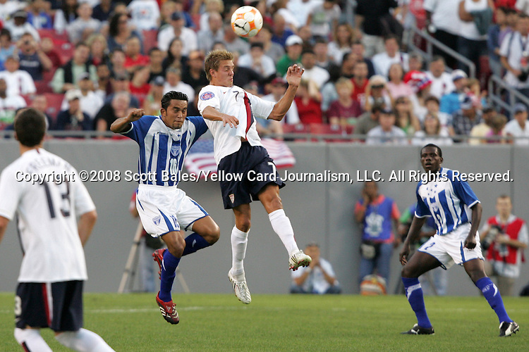 15 March 2008: Stuart Holden (USA) (7) wins a header in front of Marvin Sanchez (HON) (16). The United States U-23 Men's National Team defeated the Honduras U-23 Men's National Team 1-0 at Raymond James Stadium in Tampa, FL in a Group A game during the 2008 CONCACAF Men's Olympic Qualifying Tournament.