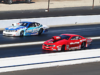 Nov 10, 2013; Pomona, CA, USA; NHRA pro stock driver Rickie Jones (near lane) races alongside Matt Hartford during the Auto Club Finals at Auto Club Raceway at Pomona. Mandatory Credit: Mark J. Rebilas-