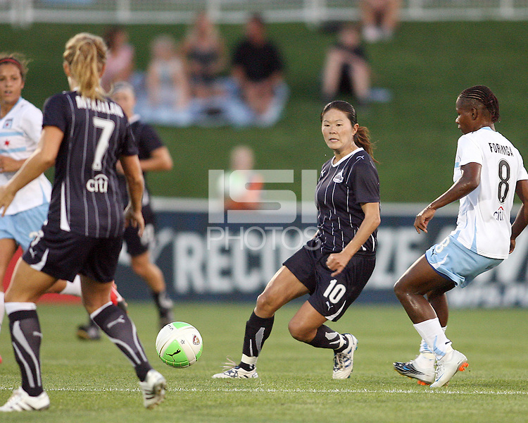 Homare Sawa #10 of the Washington Freedom sends a pass away from Formiga #8 of the Chicago Red Stars during a WPS match at Maryland Soccerplex on August 19 2010, in Boyds, Maryland. Freedom won 2-0.