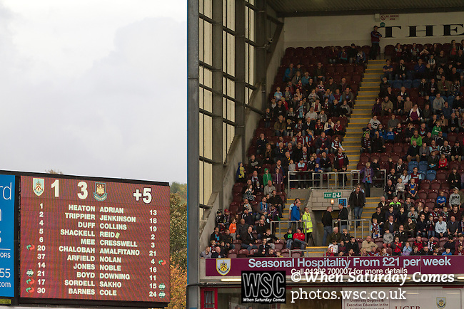 Burnley 1 West Ham United 3, 18/10/2014. Turf Moor, Premier League. Home supporters watching the final action from the Jimmy McIlroy stand as Burnley take on West Ham United in an English Premier League match at Turf Moor. The fixture was won by the visitors by three goals to one watched by 18,936 spectators. The defeat meant that Burnley still had not won a league match since being promoted from the Championship the previous season. Photo by Colin McPherson.