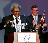 """Boxing promotor Don King speaks to supporters at the 2004 Republican """"Victory"""" Party at the Ronald Reagan Building in Washington, D.C. on November 2, 2004.  These Bush supporters were watching the vote count in the 2004 Presidential Election. Republican National Committee Chairman Ed Gillespie looks on at right.<br /> Credit: Ron Sachs / CNP"""