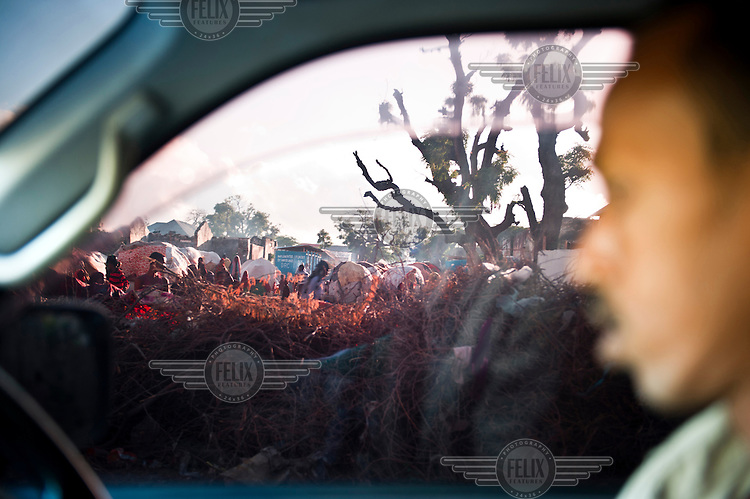 A view of an IDP (internally displaced persons) camp in Mogadishu, seen through the window of a vehicle.