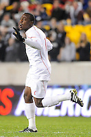 Andre Sharpe (11) of the Cincinnati Bearcats celebrates a teammates goal. The Providence Friars defeated the Cincinnati Bearcats 2-1 during the semi-finals of the Big East Men's Soccer Championship at Red Bull Arena in Harrison, NJ, on November 12, 2010.