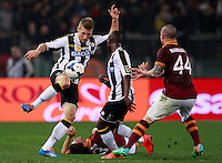 Calcio, Serie A: Roma vs Udinese. Roma, stadio Olimpico, 17 marzo 2014.<br /> Udinese defender Widmer Silvan, of Switzerland, left, kicks the ball past teammate Emmanuel Badu, of Ghana,  second from right, and AS Roma defender Dodo', of Brazil, bottom, and midfielder Radja Nainggolan, of Belgium, right, during the Italian Serie A football match between AS Roma and Udinese at Rome's Olympic stadium, 17 March 2014.<br /> UPDATE IMAGES PRESS/Isabella Bonotto