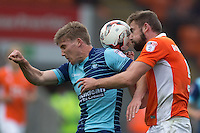 Dayle Southwell of Wycombe Wanderers battles with Clark Robertson of Blackpool during the Sky Bet League 2 match between Blackpool and Wycombe Wanderers at Bloomfield Road, Blackpool, England on 20 August 2016. Photo by James Williamson / PRiME Media Images.