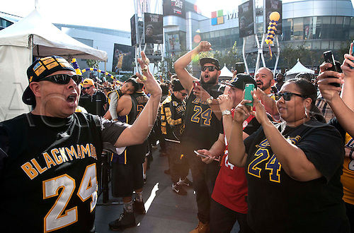 13.04.2016. Los Angeles, California, USA. Kobe fan Fernado Alvarez, of Shafter, leads a cheer during Fanfest outside Staples Center on Wednesday in Los Angeles. This was Kobe Bryant's final game.