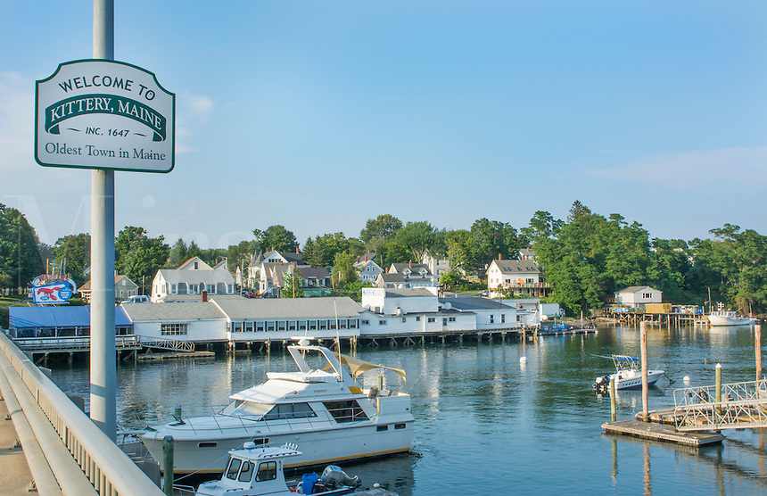 Kittery Maine sign of Welcome and marina with boats on bridge old town settled in 1647 oldest town in Maine