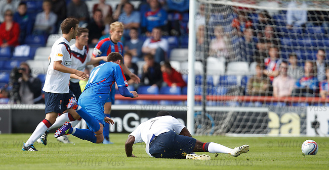 Maurice Edu fouls Nick Ross for his second yellow card and a dismissal