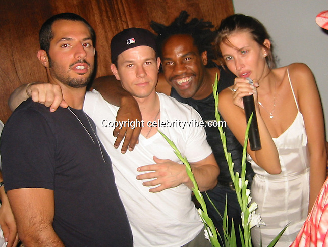 Guy Oseary, Mark Wahlberg, Unick and Rhea Durham.Candyland Party.Exit Nightclub Rooftop.New York, NY.July 19, 2001.Photo by Celebrityvibe.com..