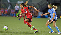 Portland, Oregon - Saturday July 2, 2016: Portland Thorns FC forward Nadia Nadim (9) dribbles away from Sky Blue FC midfielder Sarah Killion (16) during a regular season National Women's Soccer League (NWSL) match at Providence Park.