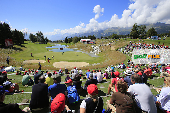 The picturesque 13th green during Saturday's Round 3 of the 2014 Omega European Masters held at the Golf Club Crans-sur-Sierre, Crans Montana, Switzerland.: Picture Eoin Clarke, www.golffile.ie: 6th September 2014