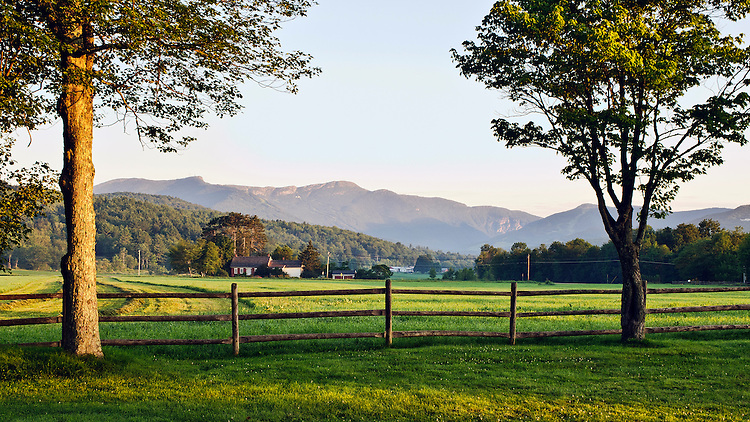 A view at dawn of Mount Mansfield and adjacent peaks, as seen from Stowe, Vermont in summer