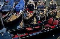 Empty gondolas floating on narrow canal, Venice, Italy.