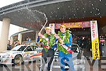 CHAMPAGNE: Thomas Fitzmaurice and his navigator Fionn Foley celebrate winning the Carlton Hotel Circuit of Kerry Rally last Sunday in Tralee.