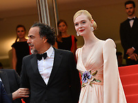 """CANNES, FRANCE. May 14, 2019: Alejandro Gonzalez Inarritu & Elle Fanning at the gala premiere for """"The Dead Don't Die"""" at the Festival de Cannes.<br /> Picture: Paul Smith / Featureflash"""