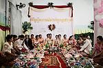 PHNOM PHEN, CAMBODIA, APRIL 2013:<br />Viton e Neary celebrano la cerimonia ufficiale del loro matrimonio nell'orfanotrofio dove sono cresciuti e dove adesso lavorano.<br />La sera  si sposteranno a Phnom Phen per festeggiare con un party<br /><br />&copy; Giulio Di Sturco per &quot;D&quot; della Repubblica