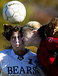 On Sat Nov 12,2005---East Brunswick's # 17 (left) Samantha Citron collides with Woodbridge's # 11 Samantha Donlon as both go to head the ball during 2nd half action at North Brunswick for the GMCT Girls Championship.