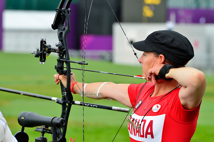 LONDON, ENGLAND 27/08/2012 - Karen Van Nest of the Canadian Paralympic Archery Team steadies herself before releasing her arrow during a training session at the London 2012 Paralympic Games at The Royal Artillery Barracks. (Photo: Phillip MacCallum/Canadian Paralympic Committee)