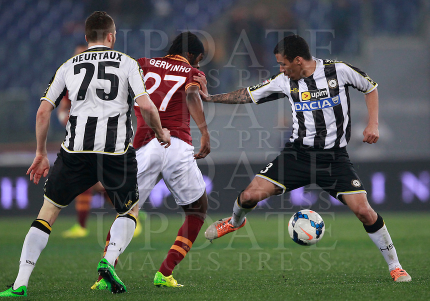 Calcio, Serie A: Roma vs Udinese. Roma, stadio Olimpico, 17 marzo 2014.<br /> AS Roma forward Gervinho, of Ivory Coast,  center, is challenged by Udinese defender Thomas Heurtaux, of France, left, and midfielder Allan Marques Loureiro, of Brazil, during the Italian Serie A football match between AS Roma and Udinese at Rome's Olympic stadium, 17 March 2014.<br /> UPDATE IMAGES PRESS/Isabella Bonotto