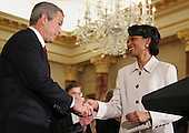 US President George W. Bush congratulates Secretary of State Condoleezza Rice during a swearing in ceremony in the Benjamin Franklin Room of the Department of State in Washington, DC Friday 28 January 2005. Secretary Rice, who is the second woman and the first black woman to become Secretary of State, was sworn in by White House chief of staff Andrew Card Wednesday evening, hours after the Senate confirmed her by a vote of 85 to 13,  in a private ceremony at the White House.<br /> Credit: Shawn Thew / Pool via CNP