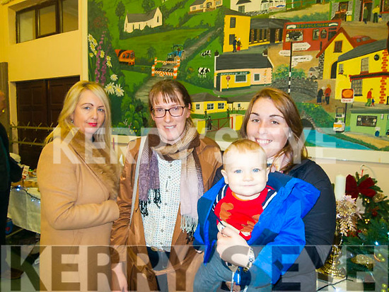 L-R Shelia McKenna, catherine Greene, Breda O'Connell with baby Paídi Horgan at the Firies Christmas fair last Sunday afternoon.