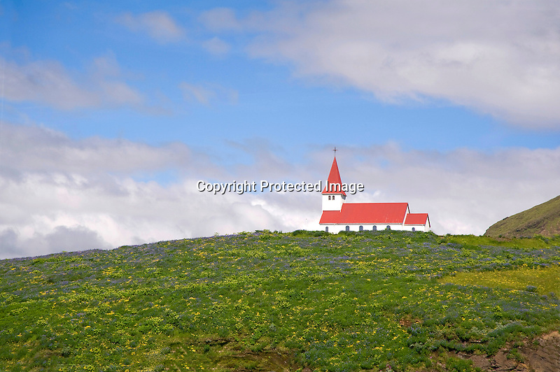 View of White and Red Roofed Hilltop Church in Vik on the South Coast of Iceland