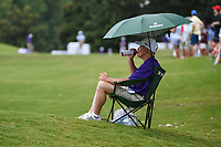 A marshal stays cool in the shade near the green on 8 during round 3 of the WGC FedEx St. Jude Invitational, TPC Southwind, Memphis, Tennessee, USA. 7/27/2019.<br /> Picture Ken Murray / Golffile.ie<br /> <br /> All photo usage must carry mandatory copyright credit (© Golffile | Ken Murray)