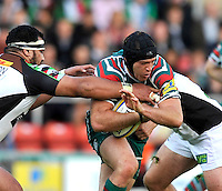 Leicester, England. Julian Salvi of Leicester Tigers tackled during the Aviva Premiership match between Leicester Tigers and Harlequins at Welford Road on September 22, 2012 in Leicester, England.