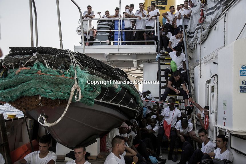 Migrants on board the Aquarius ship are taken to safe in Italy after were rescued off the shore of Libya in the Mediterranean Sea by SOS Mediterranee/MSF SAR teams.