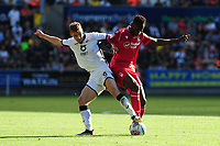 Jay Fulton of Swansea City vies for possession with Alfa Semedo of Nottingham Forest during the Sky Bet Championship match between Swansea City and Nottingham Forest at the Liberty Stadium in Swansea, Wales, UK. Saturday 14 September 2019