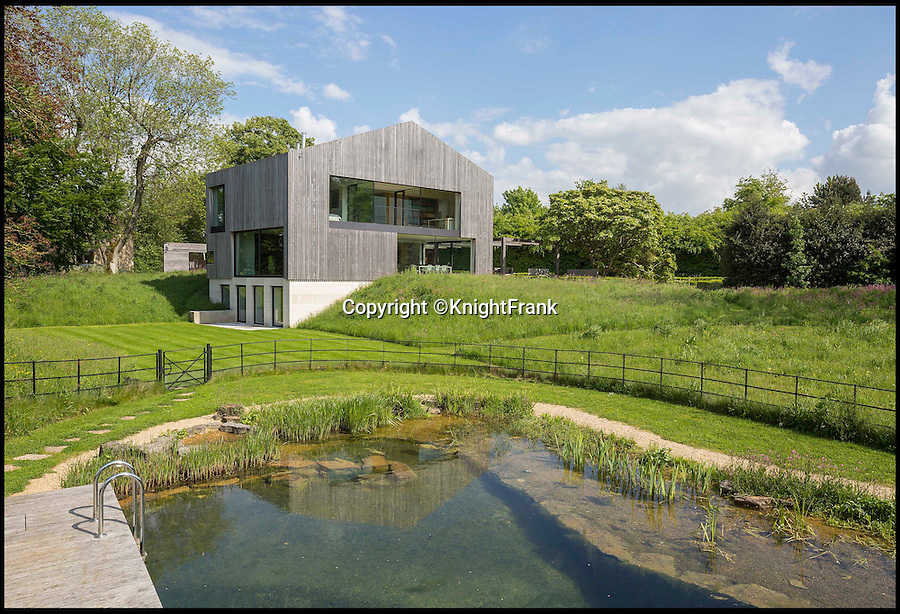 BNPS.co.uk (01202 558833)<br /> Pic: KnightFrank/BNPS<br /> <br /> The natural swimming pond.<br /> <br /> Escape the rat race...<br /> <br /> Homebuyers can get back to nature in style with this stunning modern barn which comes with its own natural swimming pond.<br /> <br /> From the outside Far End has been cleverly designed to blend into its natural surroundings but inside the £2.95million house is anything but basic.<br /> <br /> The house sits on the edge of Kingham, a village on the Gloucestershire/Oxfordshire borders, and has incredible views of the surrounding Cotswold countryside.