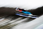 Skier jumps during the Women's Normal Hill Individual training session of the 2014 Sochi Olympic Winter Games at Russki Gorki Ski Juming Center on February 9, 2014 in Sochi, Russia. Photo by Victor Fraile / Power Sport Images
