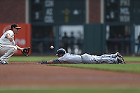 SAN FRANCISCO, CA - SEPTEMBER 23:  Everth Cabrera #2 of the San Diego Padres steals second base as San Francisco Giants second baseman Ryan Theriot #5 takes the throw during the game at AT&T Park on Sunday, September 23, 2012 in San Francisco, California. Photo by Brad Mangin