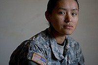 """Private First Class Kayleigh Cosay, 19 years old from While River, Arizona and with Echo Company, 1st Battalion, 506th, 101st airborne division at Forward Operating Base Corregidor in Eastern Ramadi, Al Anbar Province, Iraq on Wednesday JAN 18 2006.  When asked why  did she think she was in Iraq she replayed: """" As a Native American I feel I'm not only doing this for myself but also for my tribe. It gives me comfort knowing they are at home safe while passing our traditions to our younger generations""""."""