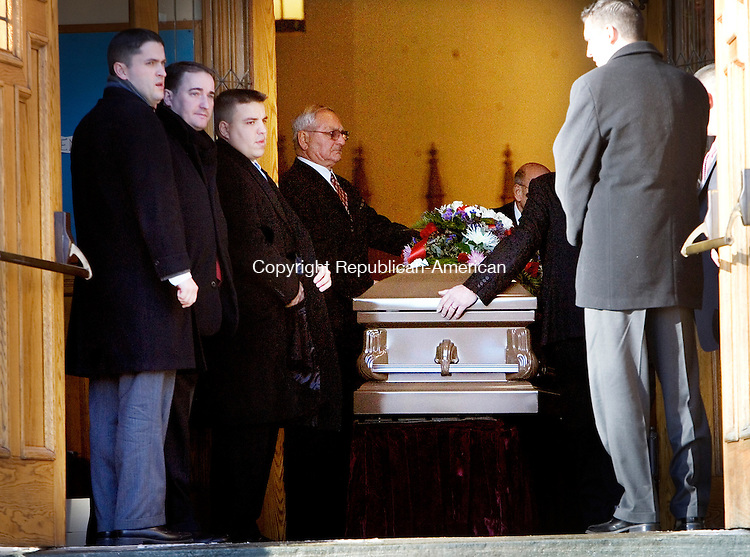 NAUGATUCK, CT 12 January 2008-011209SV02--Pallbearers carry the casket of John Massa into St. Francis Church during his funeral in Naugatuck Monday. Massa a teacher at the Waterbury Arts Magnet School died on vacation in the Bahamas.<br /> Steven Valenti Republican-American