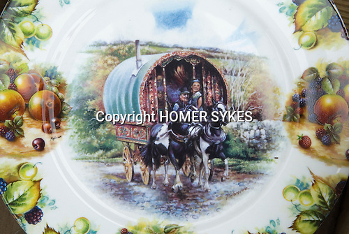 Barnet Gypsy Horse Fair Hertfordshire UK. Romantic viw of gypsy couple and traditional horse drawn caravan on plate designed for display only.