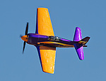 Stewart Dawson flying Rare Bear in the Unlimited Class during the National Championship Air Races at the Reno-Stead Airfield Friday, Sept. 18, 2015.