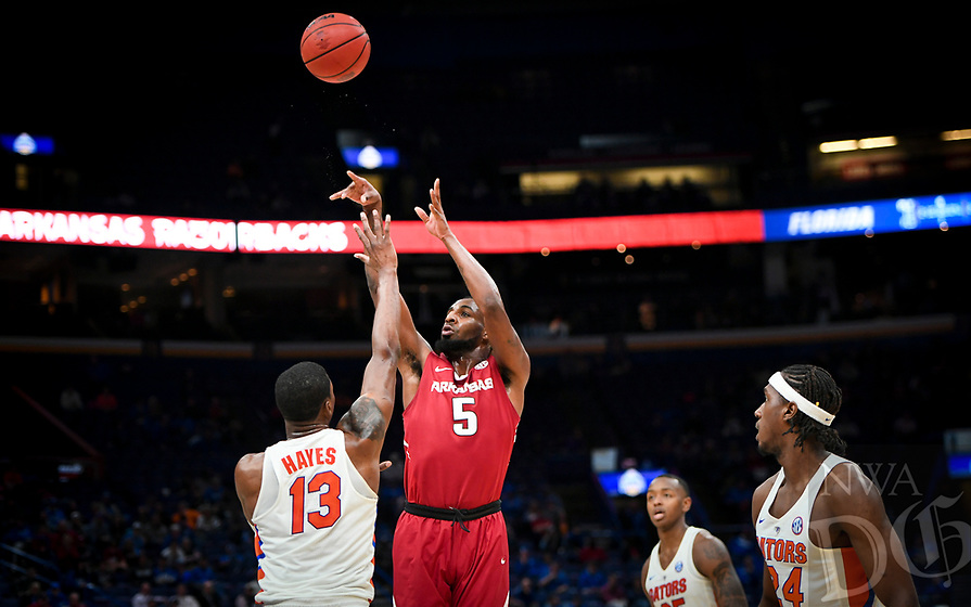 NWA Democrat-Gazette/CHARLIE KAIJO Arkansas Razorbacks forward Arlando Cook (5) shoots during the Southeastern Conference Men's Basketball Tournament quarterfinals, Friday, March 9, 2018 at Scottrade Center in St. Louis, Mo.