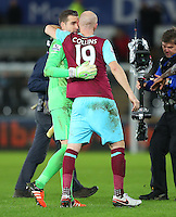 West Ham United goalkeeper Adrian and James Collins embrace at full time during the Barclays Premier League match between Swansea City and West Ham United played at The Liberty Stadium, Swansea on 20th December 2015