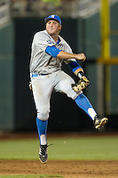 UCLA Bruin second baseman Cody Regis (18) turns a double play in the ninth inning of Game 4 of the 2013 Men's College World Series against the LSU Tigers on June 16, 2013 at TD Ameritrade Park in Omaha, Nebraska. UCLA defeated LSU 2-1. (Andrew Woolley/Four Seam Images)