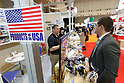 An exhibitor shows his products at the USA booth during the 42nd International Food and Beverage Exhibition (FOODEX JAPAN 2017) in Makuhari Messe International Convention Complex on March 8, 2017, Chiba, Japan. About 3,282 companies from 77 nations are participating in the Asia's largest food and beverage trade show. This year organizers expect 77,000 visitors for the four-day event, which runs until March 10. (Photo by Rodrigo Reyes Marin/AFLO)