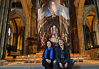BNPS.co.uk (01202 558833)<br /> Pic: ZacharyCulpin/BNPS<br /> <br /> PICTURED: Salisbury Cathedral curator Jacquiline Creswell and photographer Ash Mills<br /> <br /> One of the UK's most historic cathedrals today unveiled a 40ft Renaissance-style photographic tableau as its nativity - with its very own clergy, volunteers and staff starring as figures from the Christian scene.<br /> <br /> Salisbury Cathedral's spectacular nativity features its stonemason as Joseph, a bookings agent as Mary, a retired postman as a shepherd, a Canon and guides as Wise Men - and the son of an ex-England rugby player as baby Jesus.<br /> <br /> The Wiltshire cathedral wanted to put a modern twist on the traditional Christmas scene and cast people as Nativity characters before holding a series of individual and group photoshoots.