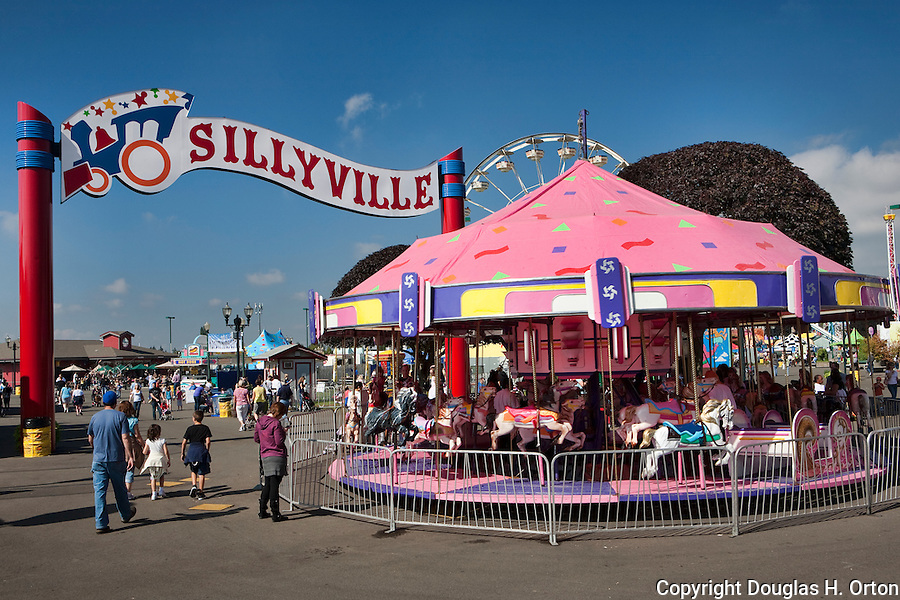 Midway rides bring thrills to fairgoers at The Puyalup Fair.  Do the Puyallup.  Western Washington State Fair.
